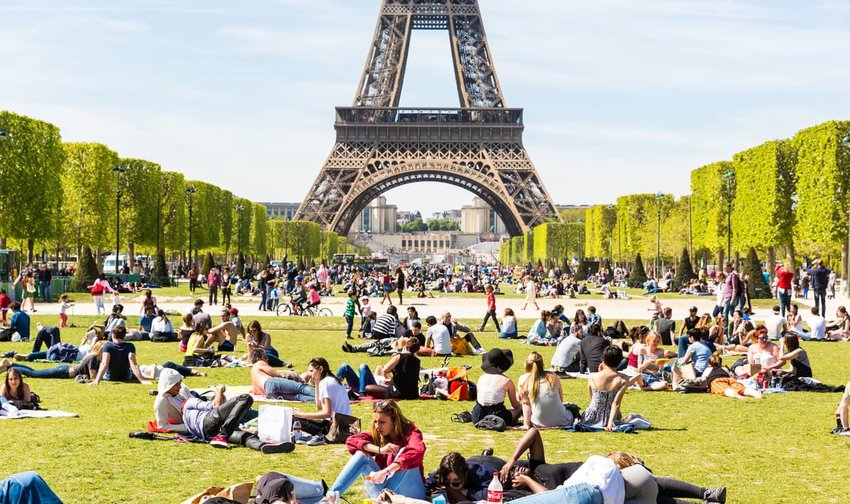 People on Champ de Mars with Eiffel Tower on background