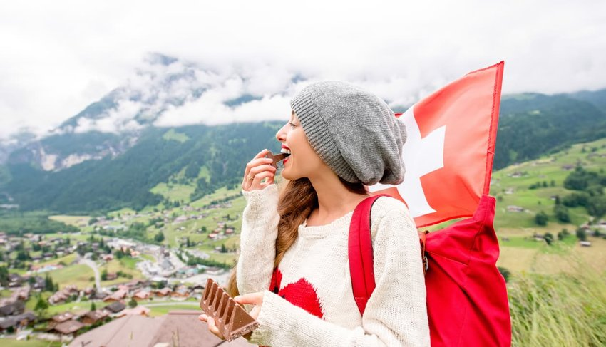 woman eating chocolate, switzerland