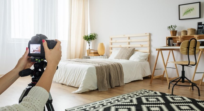 Photo being taken of a bedroom.