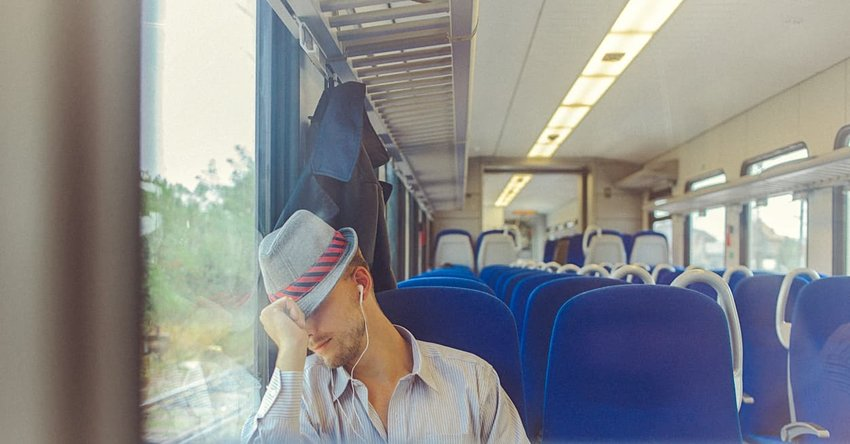 man sleeping on train during commute