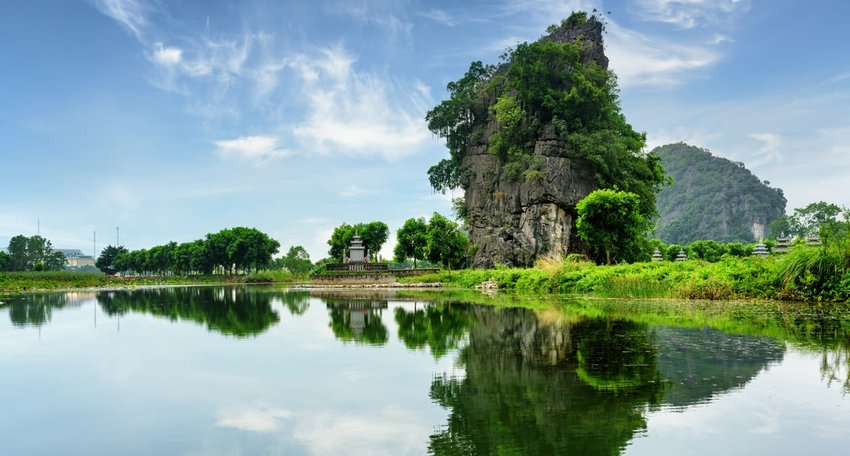 Amazing natural karst tower reflected in the Ngo Dong River, Vietnam