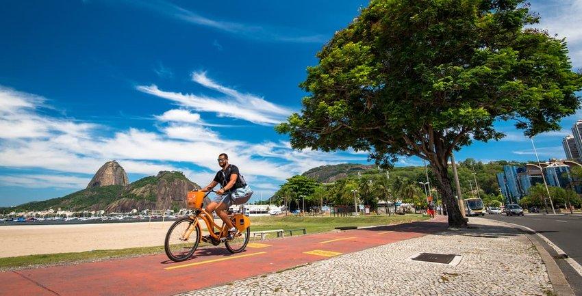 Man Cycling in Botafogo Beach, Rio de Janeiro