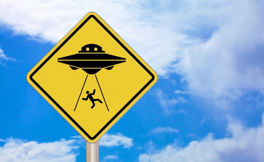 alien abduction crossing sign