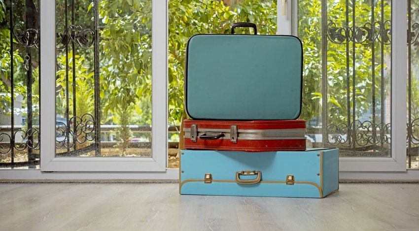 retro luggage in empty house