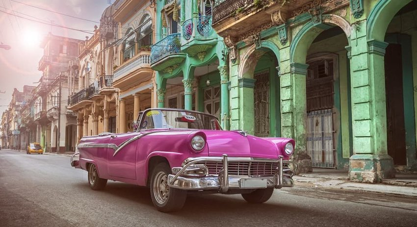 Vintage classic pink american convertible in old town of Havana Cuba