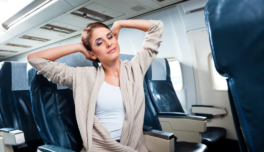 Woman stretching on an airplane