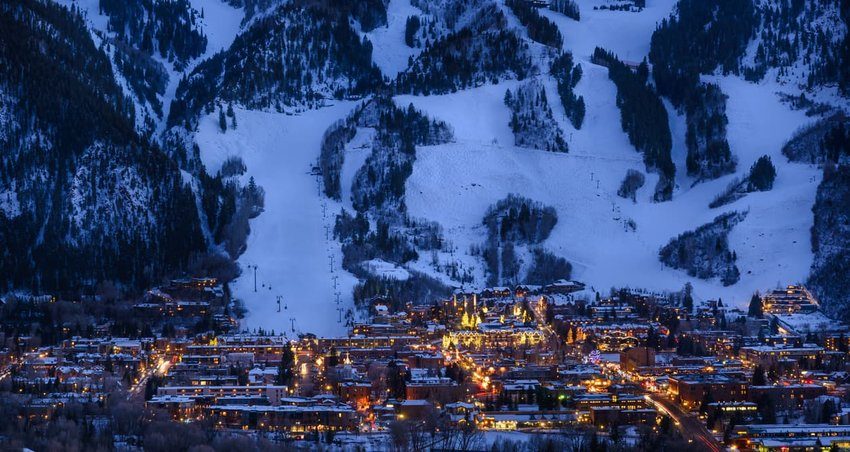 Aspen, Colorado Town and ski slopes at dusk