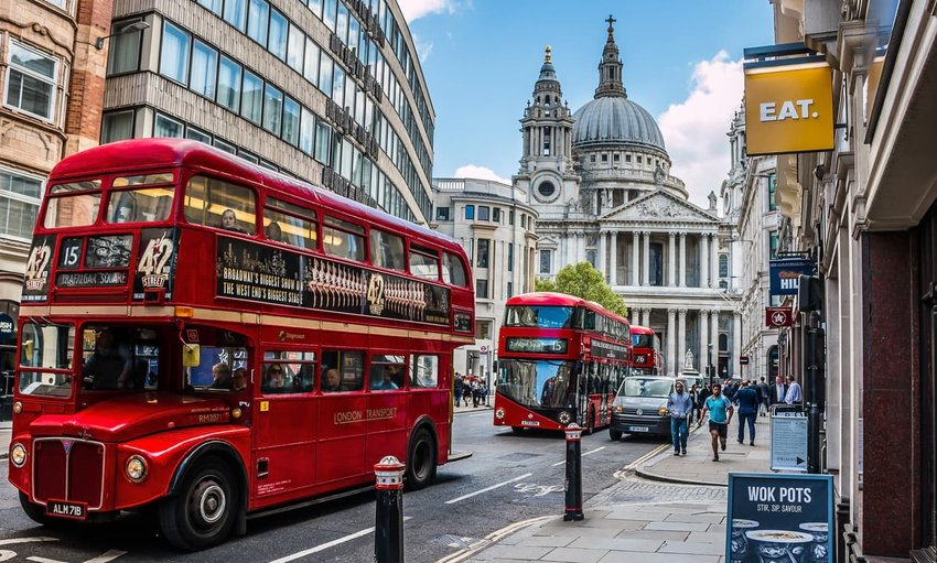 street in london with red double-decker buses