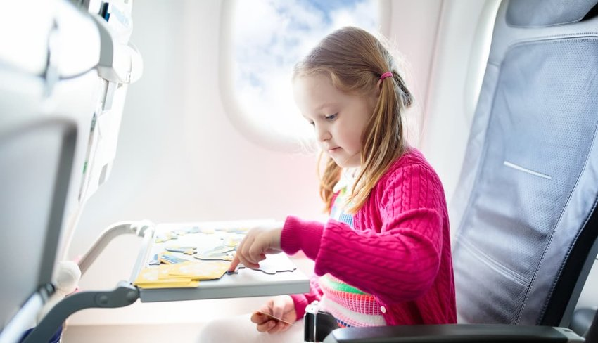 child playing on airplane