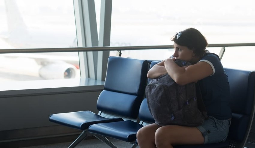 tired woman sitting in airport terminal