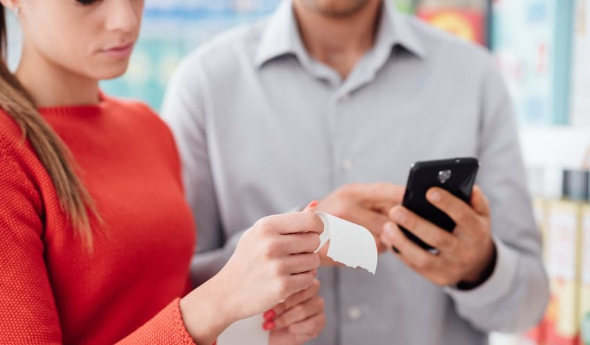young couple reviewing shopping receipt