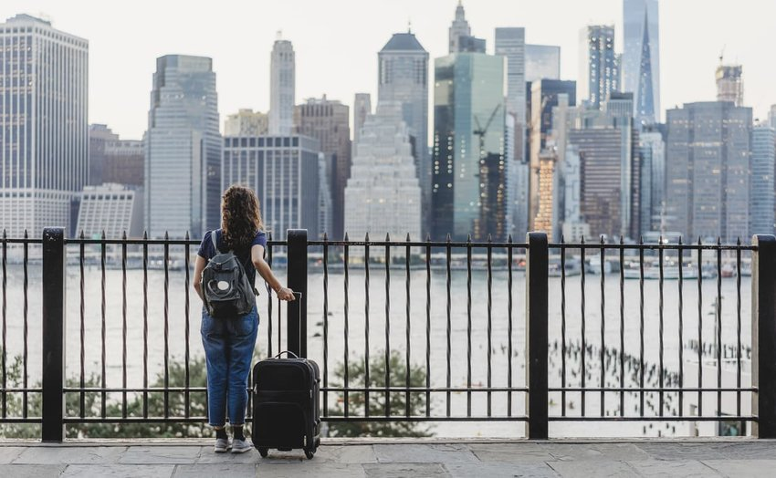 woman with suitcase in new york city