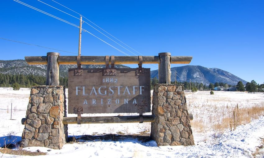 flagstaff sign with snow