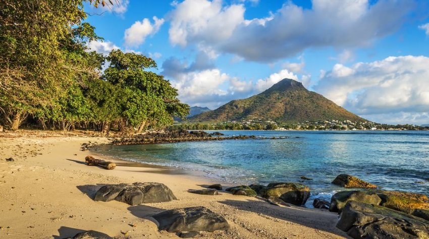 Rocky and sandy shore in Tamarin Bay, Wolmar, Flic en Flac, Mauritius Island, Indian Ocean