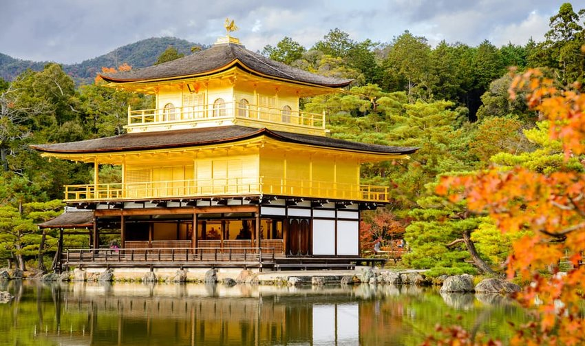 Golden Pavilion with reflections on water in red maple leave beautiful Japanese garden, Kyoto, Japan