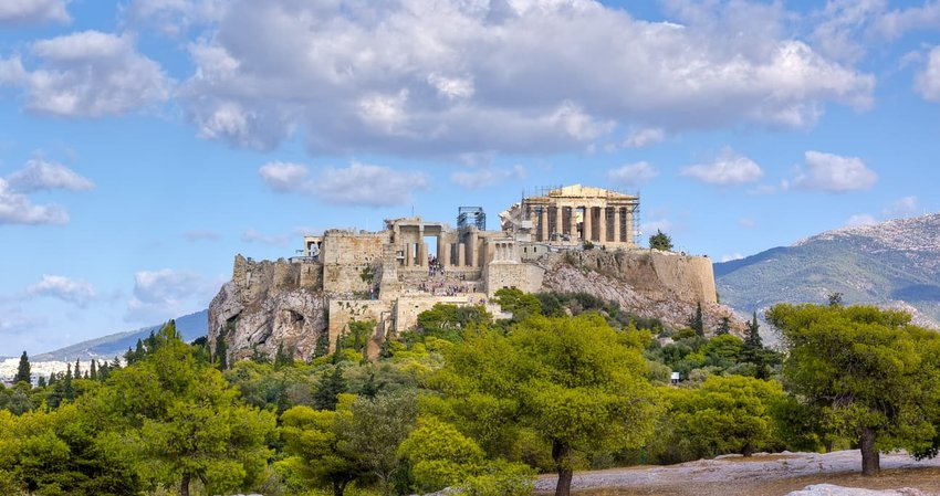 The Acropolis Athens Greece against landscape and cloudy sky