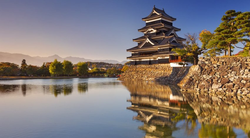 Matsumoto castle in Matsumoto, Japan at sunset