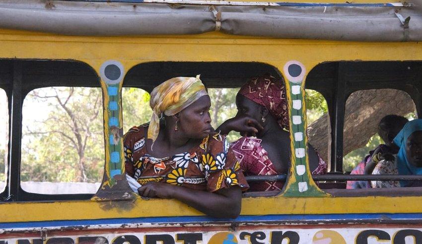 Woman leaning on a Dakar bus