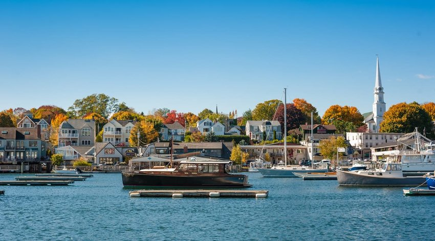 Camden, Maine harbor in autumn with boats moored in the harbor