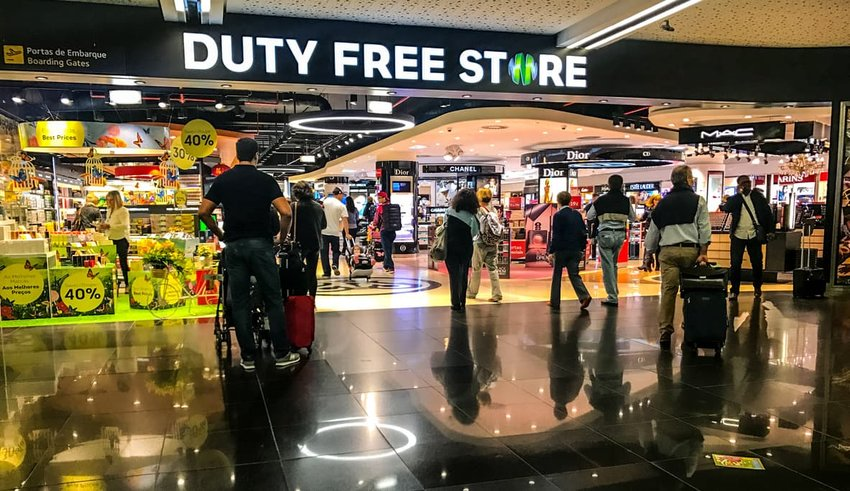people shopping at duty free store in airport