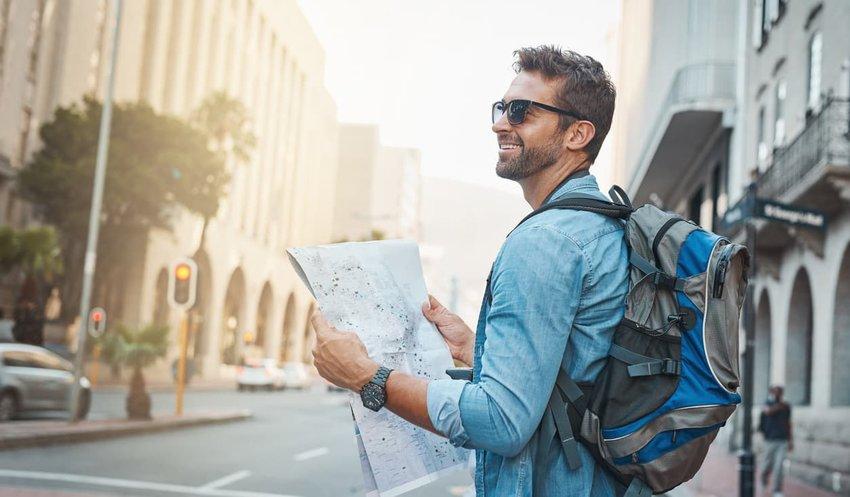 tourist man holding map