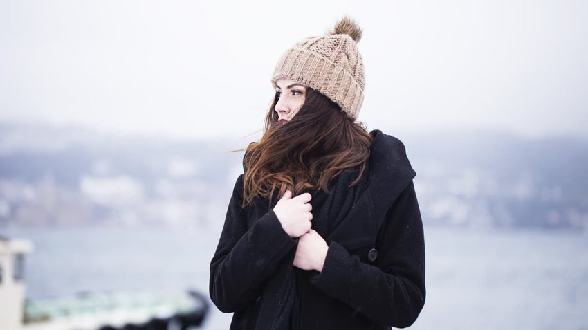 woman in winter clotes bundled up outside