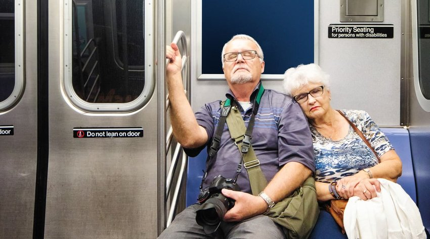 senior tourist couple asleep on the train after a long day