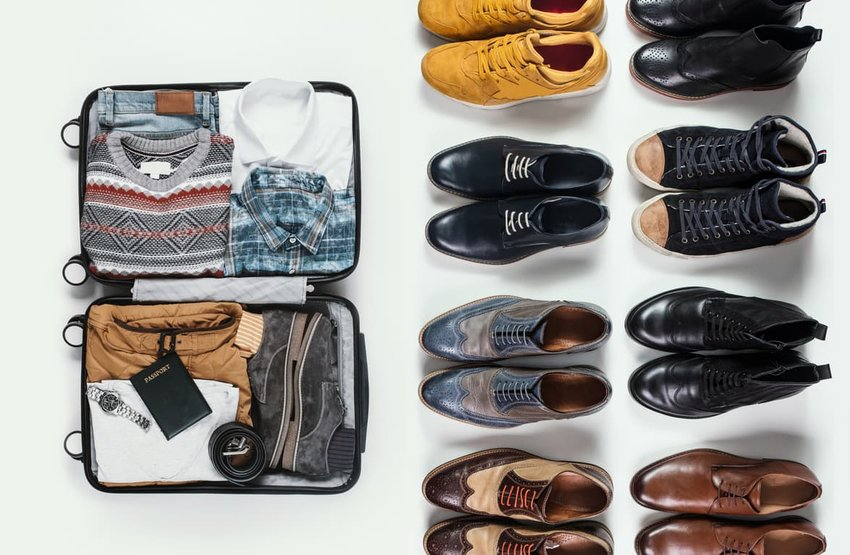 packed luggage with choice of shoes