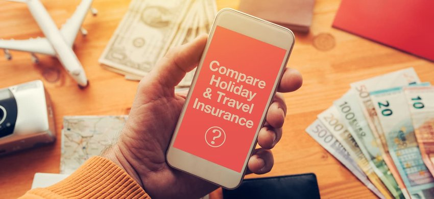 Mobile phone being used to compare travel insurance prices