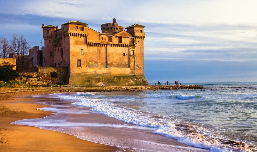 castle over sea and sunset. Santa Severa, Italy