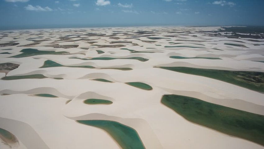 Natural rainwater pools in Lencois Maranhenses National Park seen from above, Maranhao, Brazil