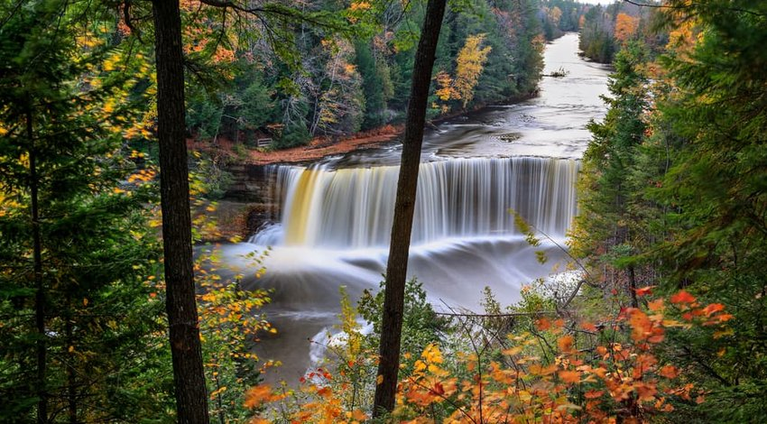 Picturesque waterfall in motion blur, Tahquamenon Falls in autumn, Michigan's Upper Peninsula