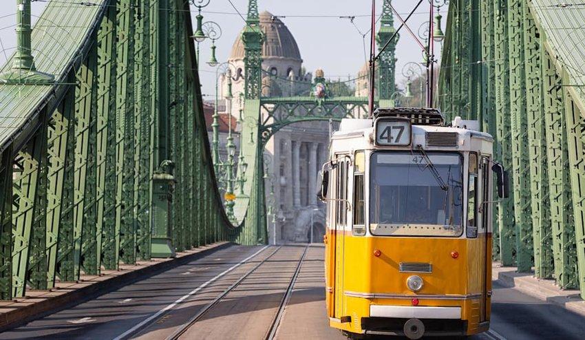 Tram-crossing-a-bridge-in-Budapest