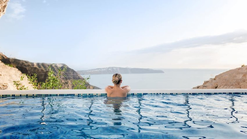 Woman-relaxing-in-a-pool-with-a-view