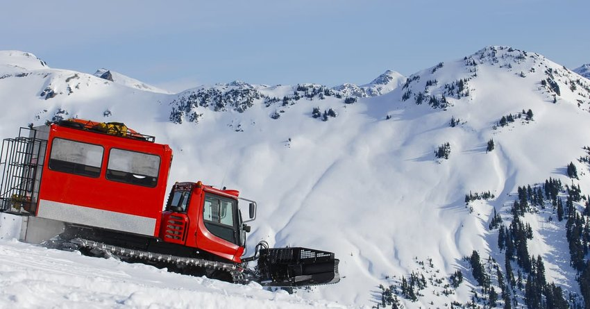 snowcat on snowy mountain