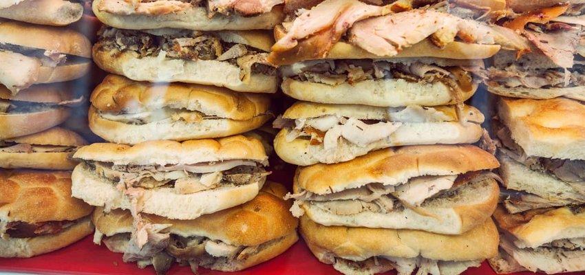 Stacked Porchetta Sandwiches in Italy