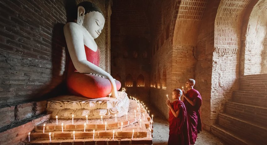 Praying Burmese Novice Monks in Stupa Temple Myanmar