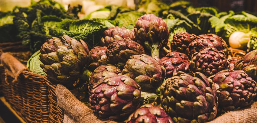 Artichokesselling at a farmers market, Rome, Italy