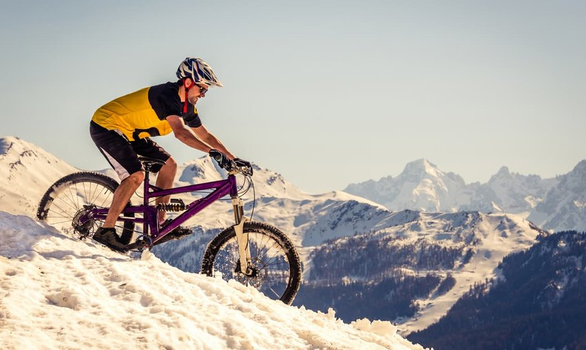 Mountain biker riding on the snow
