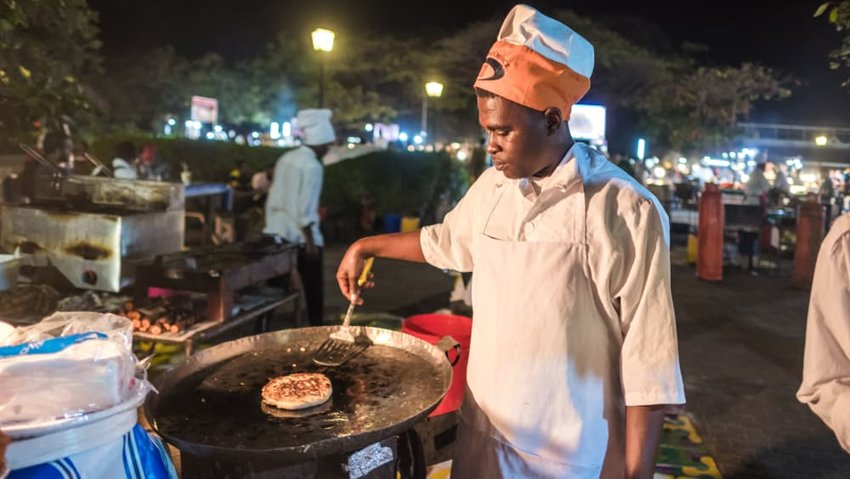 African chefs cooking Zanzibari pizza at Forodhani Gardens