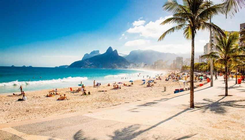 Palms and Two Brothers Mountain on Ipanema beach in Rio de Janeiro, Brazil.