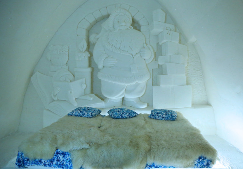 A carved ice wall above a suite in the Snow Castle hotel in Finland.