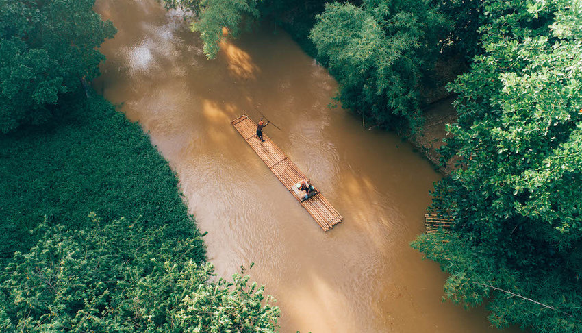 Bamboo-raft-floating-down-a-river