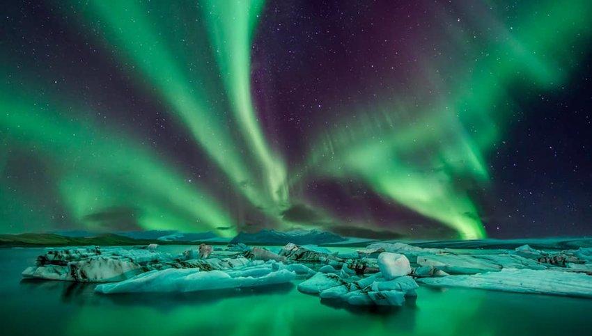 Photo of northern lights over Reykjavik, Iceland