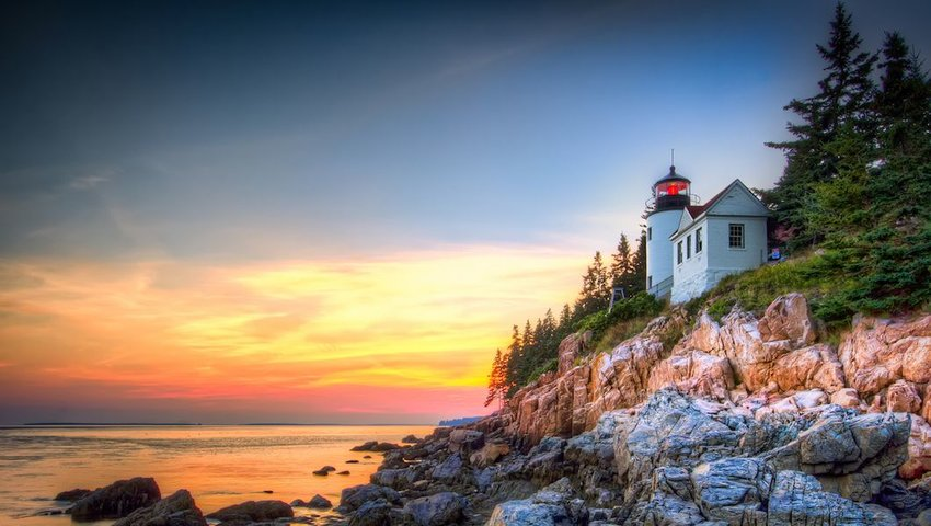 Photo of a lighthouse and rocky shoreline in Acadia National Park