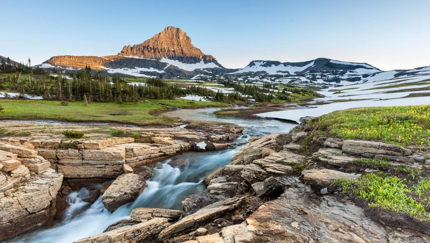 Photo of a river and mountain in Glacier National Park