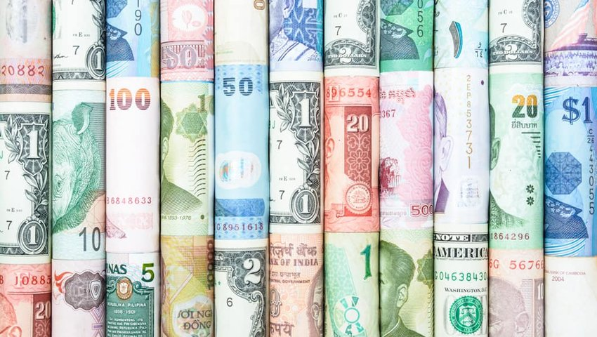 Photo of many types of currency from around the world