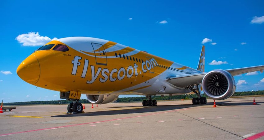 Photo of a plane that says flyscoot.com on the side
