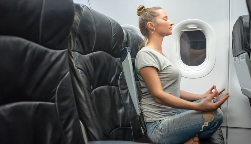 5 Stretches You Should Do Before, During and After a Long Flight