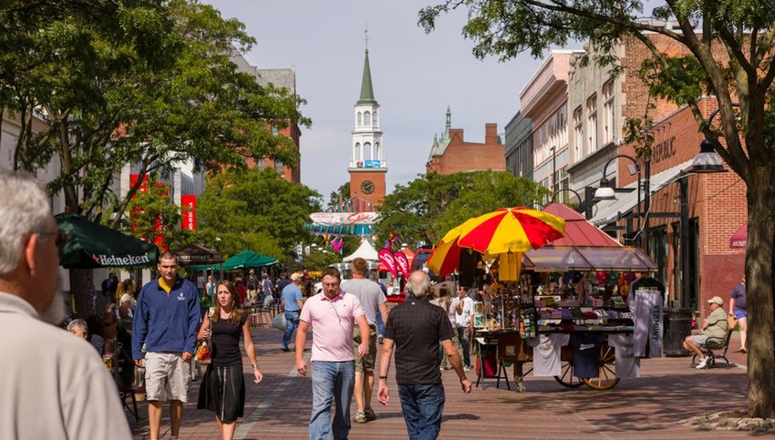 People on Church Street, a pedestrian mall with sidewalk cafes and restaurants.